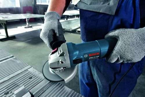sparks of angle grinder in the area of brushes cause