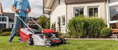how a gasoline lawn mower works